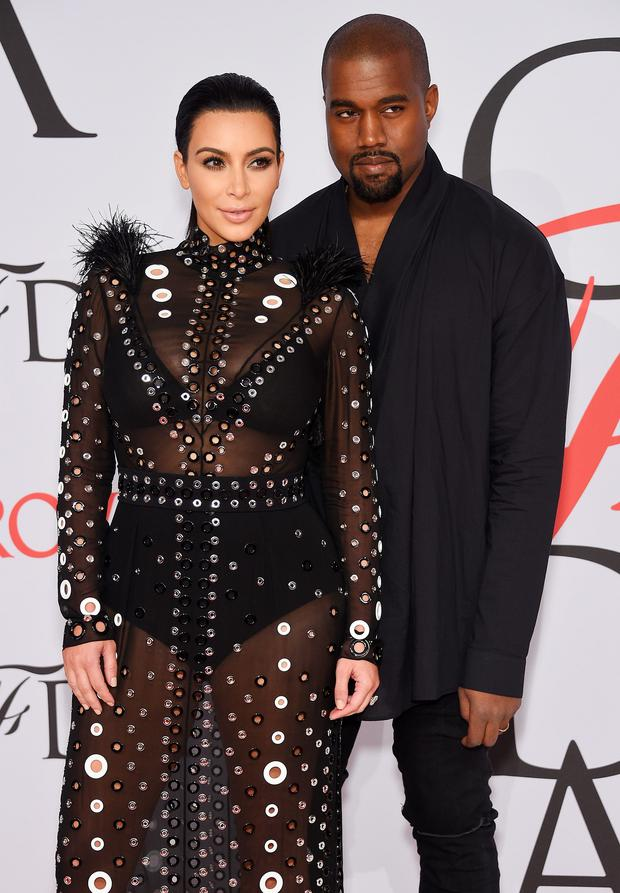 TV Personality Kim Kardashian and rapper Kanye West attend the 2015 CFDA Fashion Awards