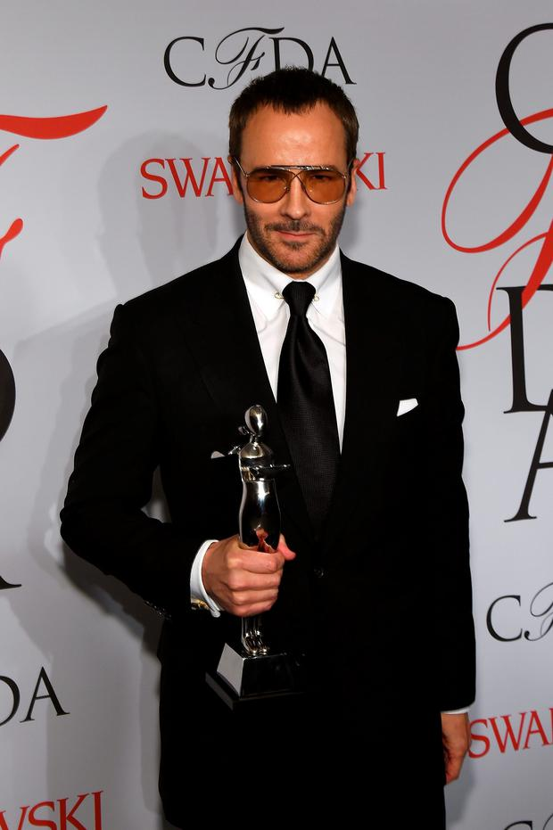 Designer Tom Ford poses on the winners walk at the 2015 CFDA Fashion Awards