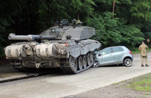 Photo of the British 'Challenger 2' tank after it rolled over a car's front in Lippe, Germany Credit: Lippe Police Departmen