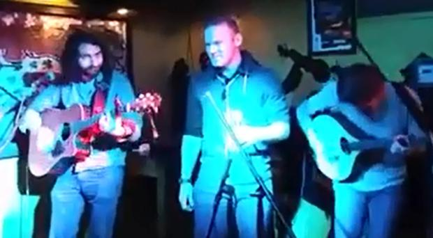 Wayne Rooney performing at The Mean Fiddler in New York