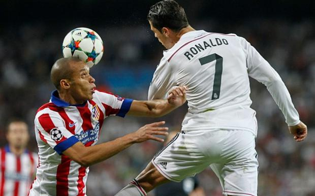 Real Madrid's Cristiano Ronaldo and Atletico Madrid defender Joao Miranda battle for the ball