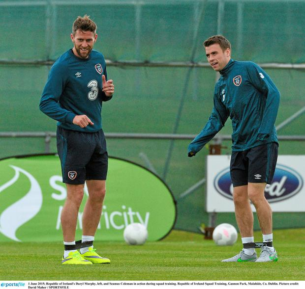 Republic of Ireland's Daryl Murphy, left, and Seamus Coleman in action during squad training