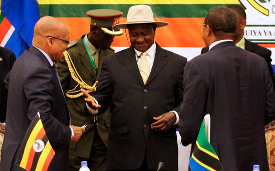 Uganda's President Yoweri Museveni (C) has been in power for more than 30 years Credit: REUTERS/Stringer