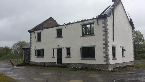 The house, being built by Crossmaglen GAA star Danny O'Callaghan, was destroyed in what neighbours called an IRA arson attack.