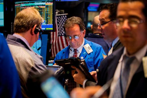 Traders work on the floor of the New York Stock Exchange shortly after the opening bell. Photo: Reuters