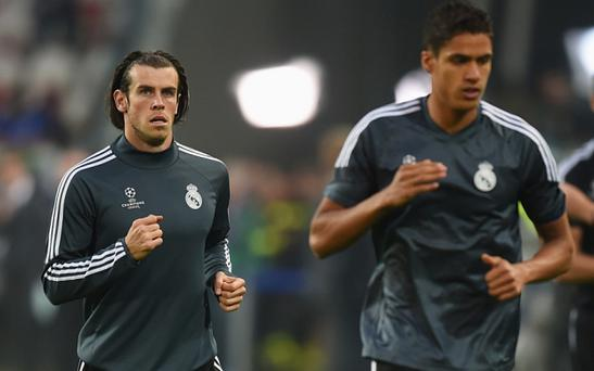 Manchester United have had an audacious bid to sign Gareth Bale (left) and Raphael Varane rejected by Real Madrid, according to Spanish media Photo: 2015 Getty Images