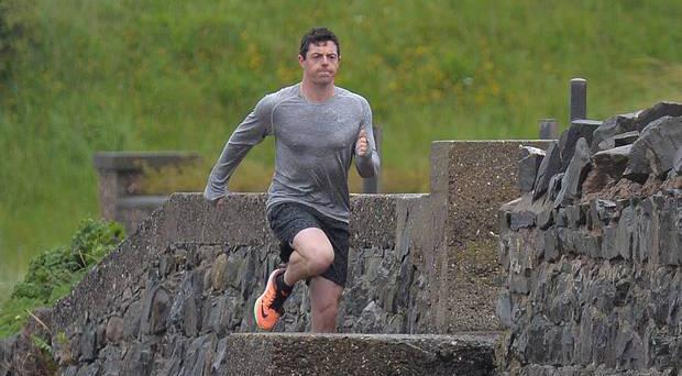 Rory McIlroy braves the elements while shooting a Nike advert in his home town. Pic: Belfast Telegraph