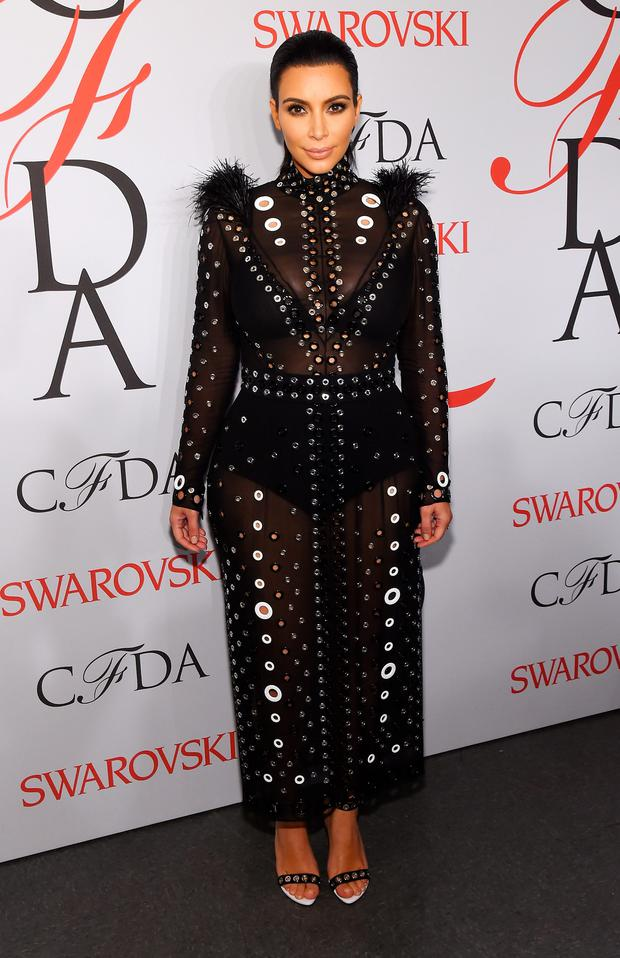 Kim Kardashian poses on the winners walk at the 2015 CFDA Fashion Awards at Alice Tully Hall at Lincoln Center on June 1, 2015 in New York City