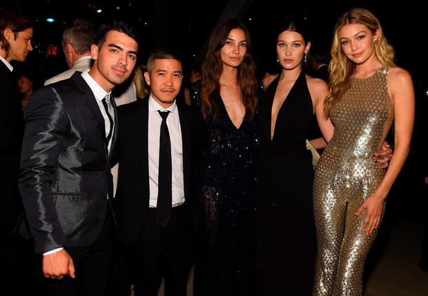 Joe Jonas, Thakoon Panichgul, Lily Aldridge, Bella Hadid, and Gigi Hadid attend the 2015 CFDA Fashion Awards at Alice Tully Hall at Lincoln Center on June 1, 2015 in New York City.
