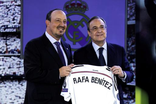 New Real Madrid head coach Rafael Benitez poses for a picture with president Florentino Perez during his presentation at Santiago Bernabeu stadium