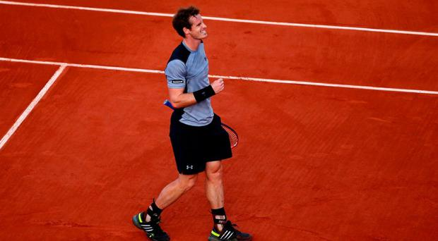 Andy Murray celebrates match point in his French open quarter-final match against David Ferrer of Spain