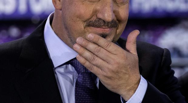 Rafael Benitez holds back the tears on his emotional 'homecoming' to Real Madrid yesterday