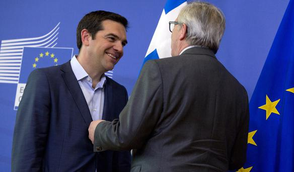 European Commission President Jean-Claude Juncker, right, speaks with Greek Prime Minister Alexis Tsipras as they arrive for a meeting at EU headquarters in Brussels on Wednesday, June 3, 2015. (AP Photo/Virginia Mayo)