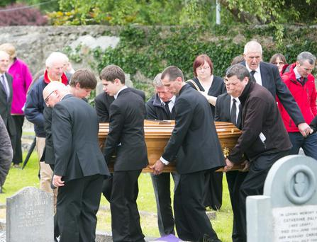 The coffin of Thomas Ruttle is carried by relatives from St Mary's Church of Ireland in Askeaton, Co Limerick