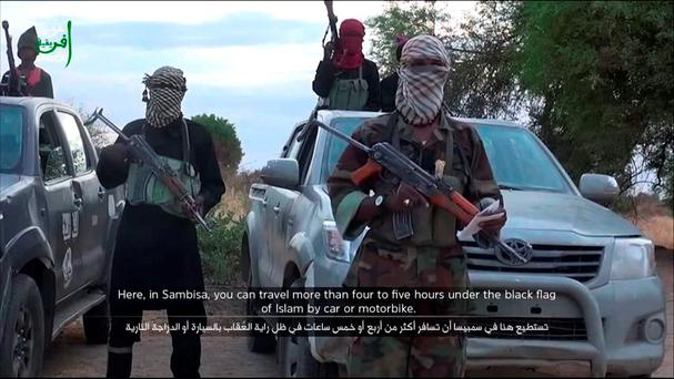 A screen grab of a Boko Haram member delivering a speech in Nigeria in a propaganda video