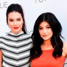 Kendall Jenner (L) and Kylie Jenner attend a launch party for thier Kendall + Kylie fashion line at TopShop on June 3, 2015 in Los Angeles, California. (Photo by Jason Merritt/Getty Images)
