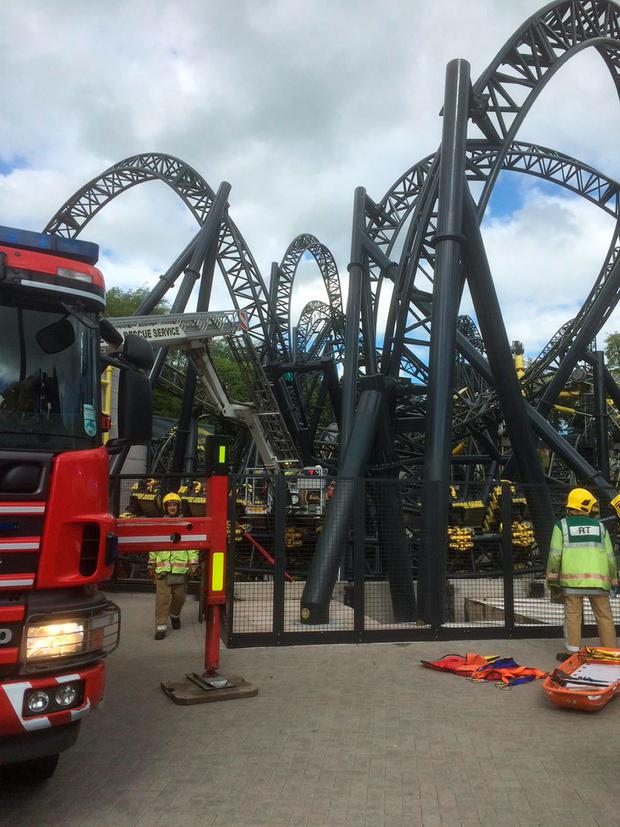 Scene at Alton Towers as four teenagers have suffered serious leg injuries in a collision between two carriages on the amusement park's Smiler rollercoaster Credit: West Midlands Ambulance Service/PA Wire