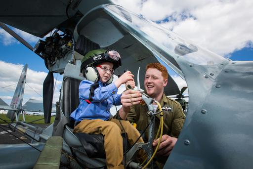 Pilot Harry Humphrys shows Donnacha Ryan from Limerick his light aircraft at the launch of the Shannon Airport airshow. Photo: Sean Curtin.