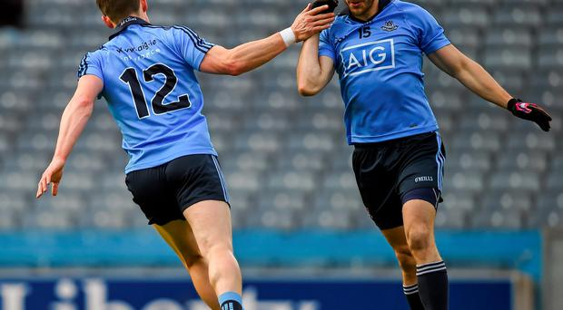Diarmuid Connolly celebrates scoring the first Dublin goal with team-mate Bernard Brogan