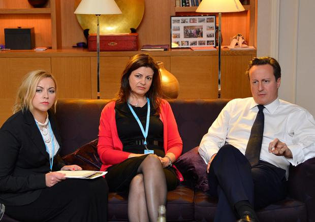 Birmingham, England, October 09: British Prime Minister David Cameron (R) listens to singer Charlotte Church (L) and former police officer Jacqui Hames (C) during a private meeting at the Conservative Party conference on October 9, 2012 in Birmingham, England.