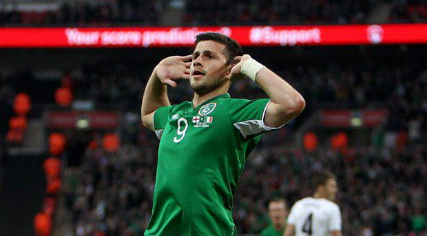 Republic of Ireland's Shane Long celebrates scoring the opening goal of the game during the International Friendly match at Wembley Stadium, London. PRESS ASSOCIATION Photo. Picture date: Wednesday May 29, 2013. See PA story SOCCER England. Photo credit should read: John Walton/PA Wire. RESTRICTIONS: Use subject to FA restrictions. Editorial use only. Commercial use only with prior written consent of the FA. No editing except cropping. Call +44 (0)1158 447447 or see www.paphotos.com/info/ for full restrictions and further information.