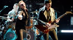 INGLEWOOD, CA - MAY 27: The Edge, Larry Mullen Jr and Bono of U2 performs at The Forum May 27, 2015 in Inglewood, California. (Photo by Jeff Kravitz/FilmMagic)
