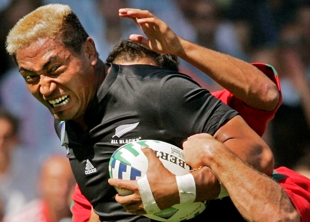 New Zealand's captain Jerry Collins runs with the ball during the Rugby World Cup match against Portugal in Lyon, France in this September 15, 2007 file picture