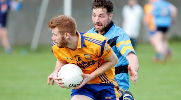 Na Fianna's Aaron Byrne gets away from UCD's Brian Meade