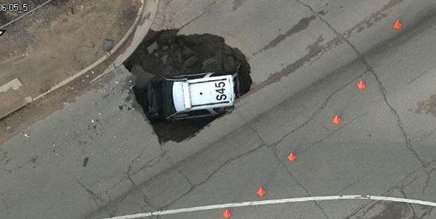 The officer was on patrol when the sinkhole opened up Credit: 9NEWS Denver