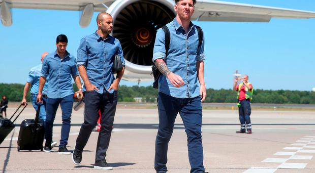 Lionel Messi arrives in Berlin alongside his team-mates Javier Mascherano and Luis Suarez