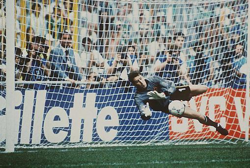 Republic of Ireland goalkeeper Packie Bonner saves Romania's Daniel Timofte's penalty during the 1990 World Cup, Second Round. Picture credit; Ray McManus / SPORTSFILE