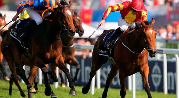 Colm O'Donoghue drives Qualify (right) to victory from Legatissimo (Ryan Moore) in the Epsom Oaks