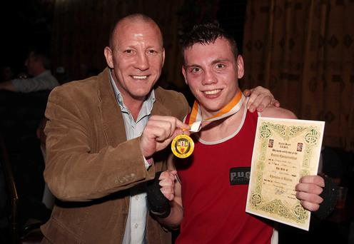 Father and son at a boxing tournament. Picture by Kelvin Boyes / Press Eye.