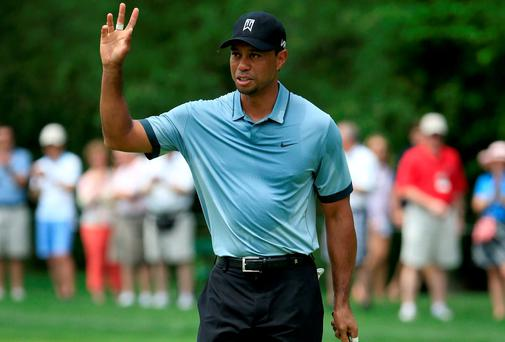 Tiger Woods waves to the gallery after making a birdie putt on the first hole at the Memorial Tournament at Muirfield in Ohio. Photo: Sam Greenwood/Getty Images