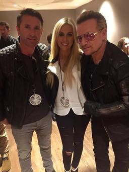 Robbie and Claudine Keane pictured with Bono