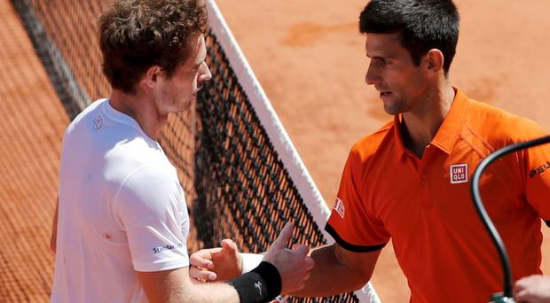 Novak Djokovic of Serbia (R) shakes hands with Andy Murray of Britain after winning their men's semi-final match at the French Open tennis tournament at the Roland Garros stadium in Paris, France, June 6, 2015. REUTERS/Jean-Paul Pelissier