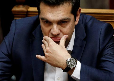 Greek Prime Minister Alexis Tsipras is pictured before his speech at a parliamentary session to brief lawmakers over the ongoing talks with the country's lenders, in Athens, Greece June 5, 2015. Tsipras on Friday branded a cash for reforms proposal by his country's creditors an