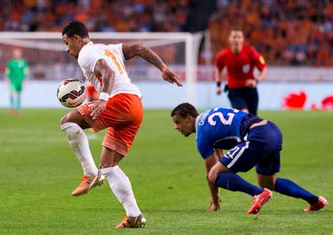 Memphis Depay of the Netherlands (L) challenges Timmy Chandler of the U.S. during their friendly soccer match at the Amsterdam Arena in Amsterdam last night