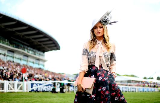 Laura Whitmore poses for photographers on Derby Day of the 2015 Investec Derby Festival at Epsom Racecourse, Epsom. Photo: Steve Parsons/PA Wire.