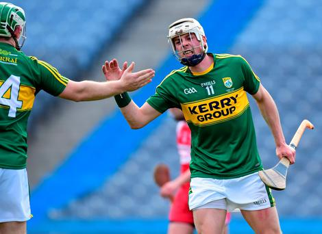 Kerry's Shane Nolan is congratulated by team-mate Padraig Boyle after scoring the only goal in their contest against Derry