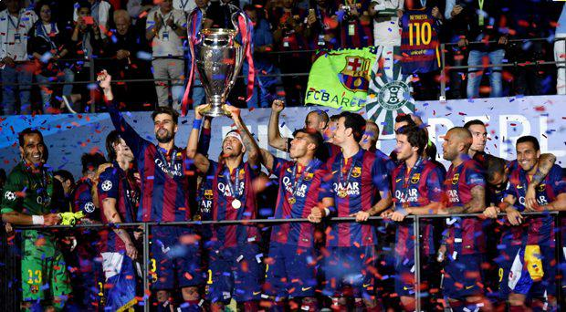 Barcelona's Neymar celebrates with the trophy and team mates after winning the UEFA Champions League
