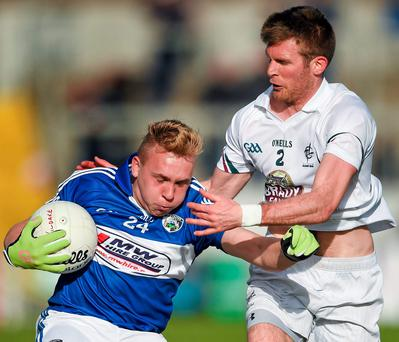 Tom Shiel of Laois in action against Kildare's Ciaran Fitzpatrick in Tullamore last night. Photo: Stephen McCarthy