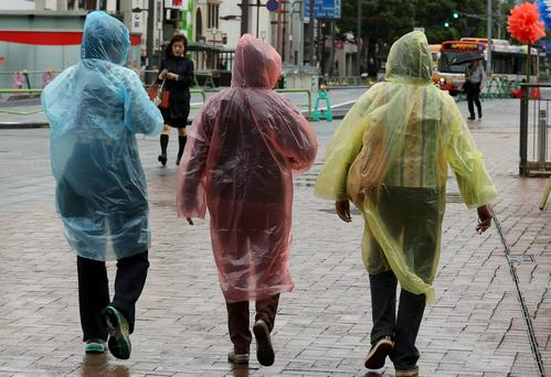 'The weather may be wobbly, but you can still tell it's summer by the plethora of plastic-poncho-clad tourists wandering the country'