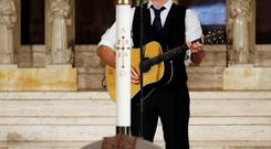 Chris Martin of the band Coldplay sings during the funeral for Vice President Joe Biden's son