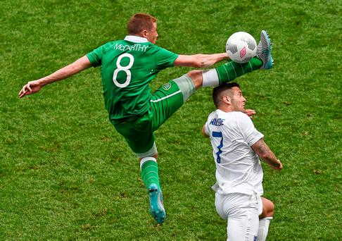 James McCarthy gets a leg up on England's Jack Wilshere