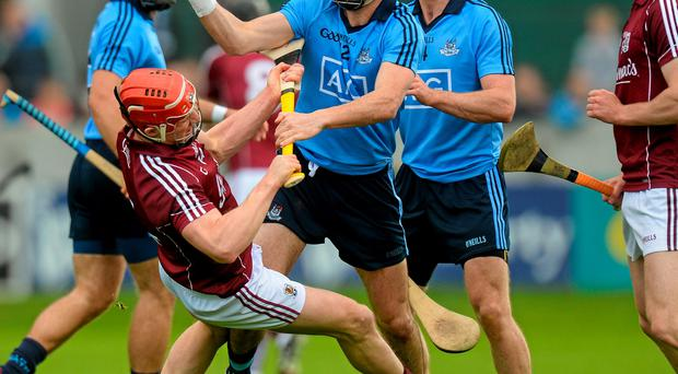 Dublin's Danny Sutcliffe tangles with Galway's Joe Canning during their replay at O'Connor Park, Tullamore on Saturday