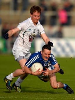 Niall Donoher of Laois falls to the ground under pressure from Kildare's Eoghan O'Flaherty