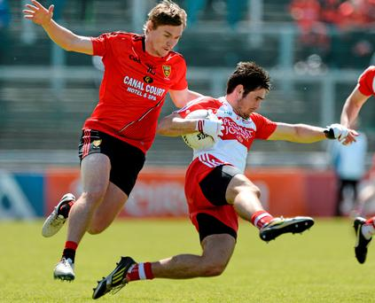 Derry's Chrissy McKaigue in action against Down's Caolan Mooneyduring their Ulster SFC clash in Celtic Park