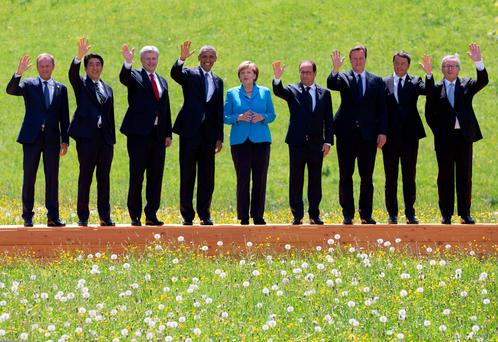 President of the European Council Donald Tusk, Japanese Prime Minister Shinzo Abe, Canadian President Stephen Harper, US President Barack Obama, German Chancellor Angela Merkel, French President Francois Hollande, British Prime Minister David Cameron, Italian Prime Minister Matteo Renzi and President of the European Commission Jean-Claude Juncker pose for the group photo at the summit of G7 nations at Schloss Elmau, in Germany