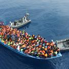The LÉ Eithne approaches an overloaded vessel in the Mediterranean